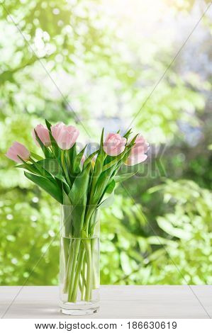 Pink tulips bouquet background. Flowers at summer garden background with copy space. Mockup for greeting card
