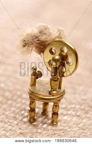 Antique Bobbin Or Weaving Loom On Texture Background