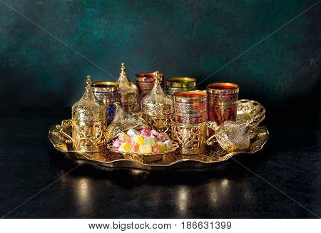 Tea table with golden dishes. Oriental hospitality. Ramadan kareem