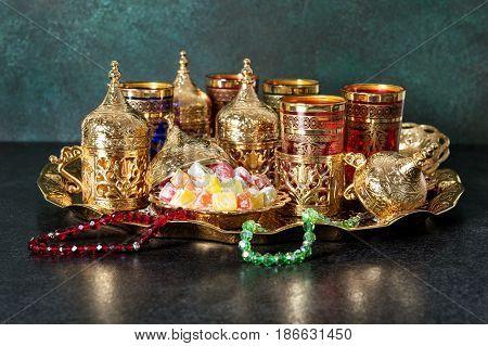 Festive tea table setting. Oriental hospitality. Ramadan kareem. Eid Mubarak
