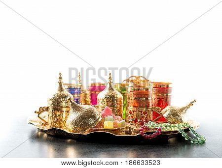 Arabic tea coffee table golden cups. Oriental hospitality. Ramadan kareem