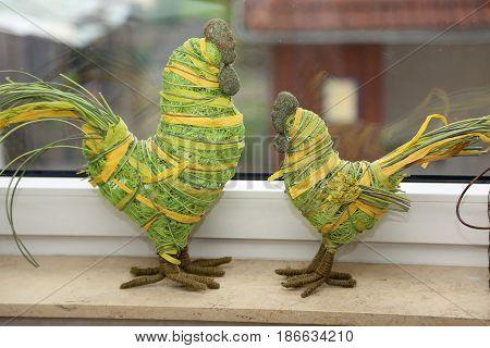 Decoration / Decorative cockerels on the windowsill