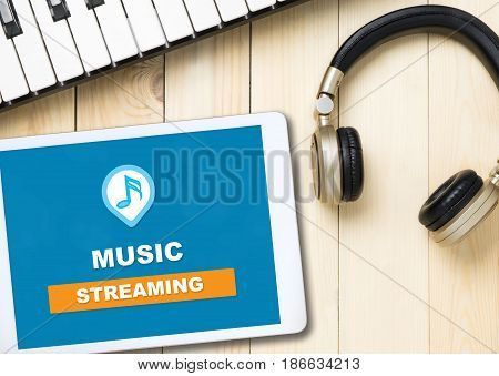 Music Streaming Application icon on tablet with headphone