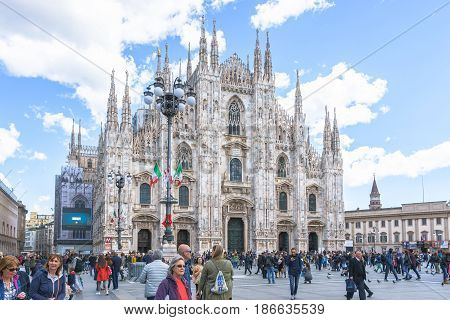 Milan Italy - April 28 2017: Daytime front view of famous Milan gothic cathedral church (Duomo di Milano) in Milan Italy.