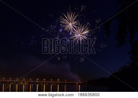 A collage of exploding fireworks in the night. Decorated with light spots. Good for holiday background.