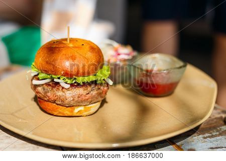 Close up of delicious fresh burger with cheese and bacon