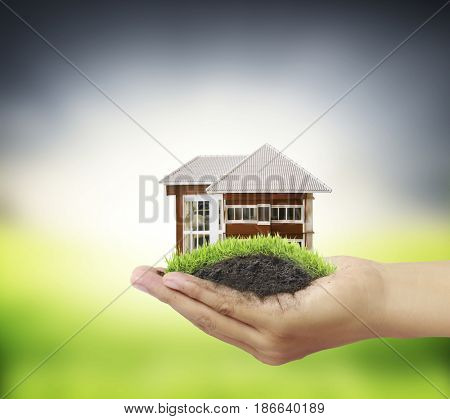 Business man house in human hands