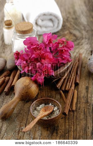 spa setting with branch red flower on old wooden background
