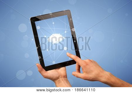Female fingers touching tablet with cloud concept