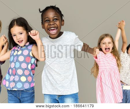 Group of happiness little children holding hand together