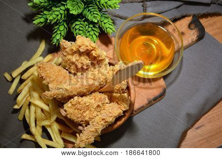 fried chicken platter accompanied by honey and chips