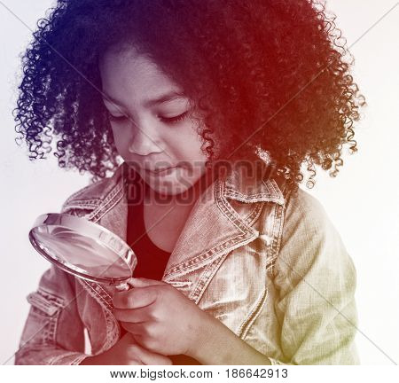 Kid using Magnifying Glass to explore