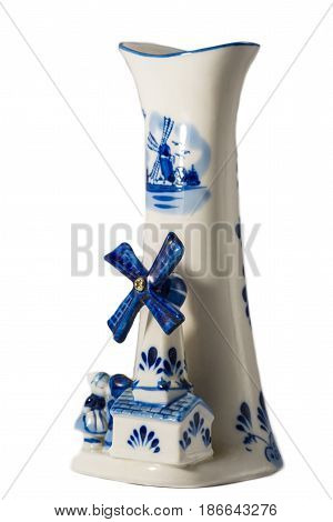 retro blue Delft porcelain windmill with couple in love, isolated on white, dutch souvenir