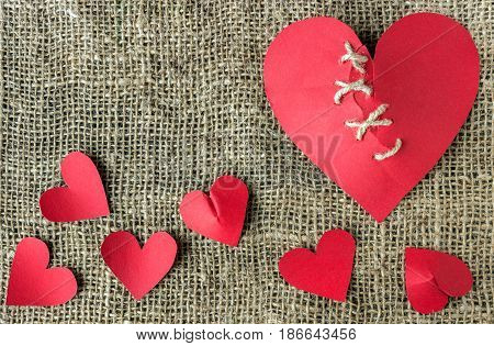 A broken red heart. Sewn thread. The concept of divorce separation quarrel.