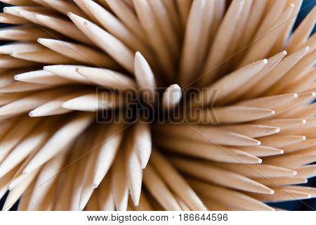 Top view of beautifully laid wooden toothpicks. Macro.