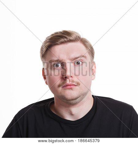 Surprised. Wonder man expressing amaze on face, standing on white isolated background, studio shot
