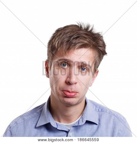 Facial expressions. Sad disappointed man looking to camera isolated on white background