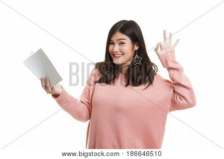 Young Asian Woman Show Ok With A Book.