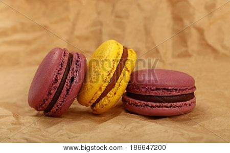 French Macaron Cookies On Brown Paper Parchment