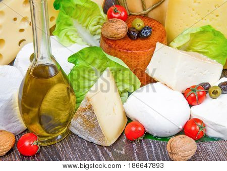 group of Various types of cheese on wood