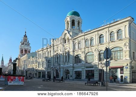 MOSCOW, RUSSIA - FEBRUARY 6, 2017: Nikolskaya street view of the Profitable house with the belfry of the St. Nicholas Greek Monastery (1902)