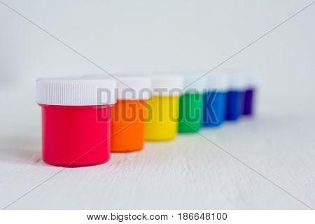 Jars of paint. Gouache. The concept of creativity. Selective focus.