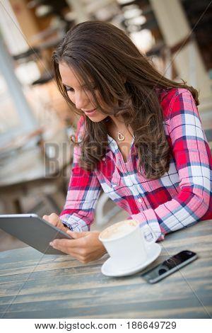 Beautiful woman using digital tablet