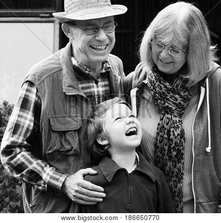 Grandparents and Grandson Smiling Cheerfully Together