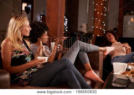 Three friends enjoy girlâ??s night in with a Chinese take-away