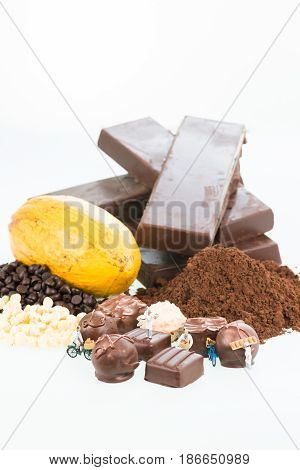 Miniature pastry chefs and cocoa over white background