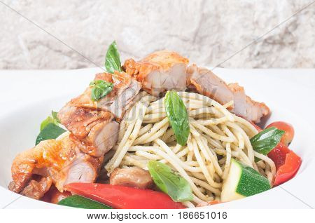Spaghetti with roasted chicken and parmesan cheese