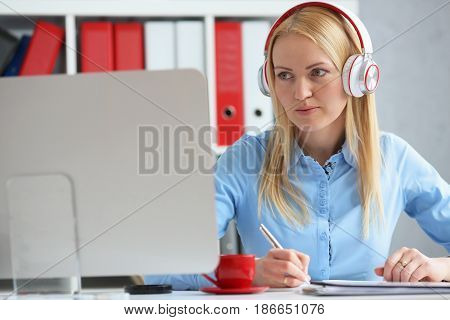 Business Woman Studying Online. Listens Lecture Looks At The Desktop Monitor.