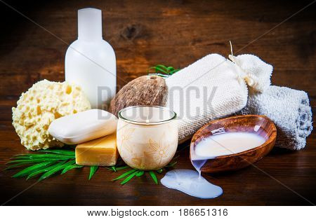 group of spa coconut products on wood