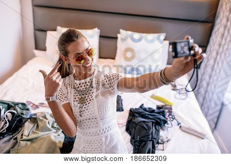 Young Woman Taking A Selfie Wearing Colorful Goggles.
