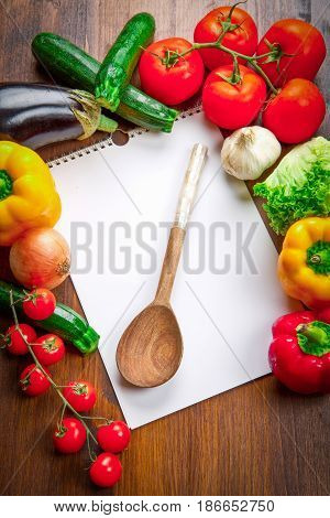 a blank recipe book and food ingredients