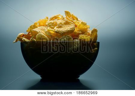 the a yellow corn flakes in a bowl