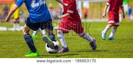 Football Soccer Match for Children. Boys Running and Kicking Football Soccer Ball. Kids Playing Soccer Game Tournament