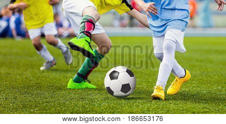 Children Football Players Running After the Ball. Kids Sport Duel. Running Youth Soccer Football Players. Boys Kicking Soccer Match