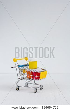 The Paint And Brushes In The Cart On