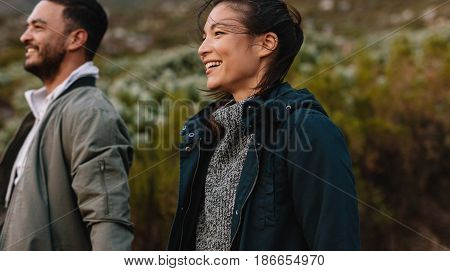 Smiling Couple Hiking In Countryside