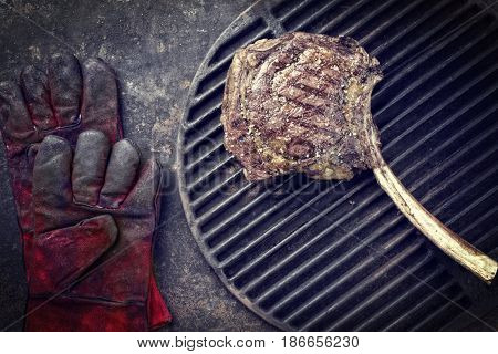 Barbecue Wagyu Tomahawk Steak as top view on used grillage