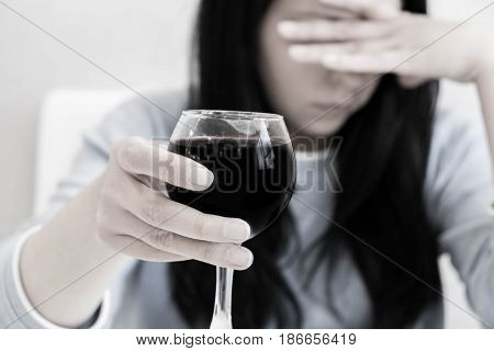 Asian Woman Drinking Alcohol. Focus On Wine Glass. Female With Glass Red Wine. Addiction Concept, Sh