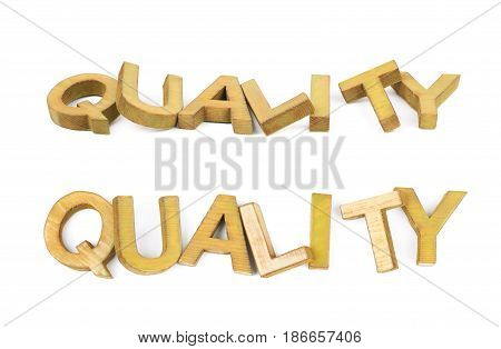 Word Quality made of colored with paint wooden letters, composition isolated over the white background, set of two different foreshortenings