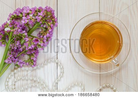 A bunch of badana and medicinal tea on a wooden background.