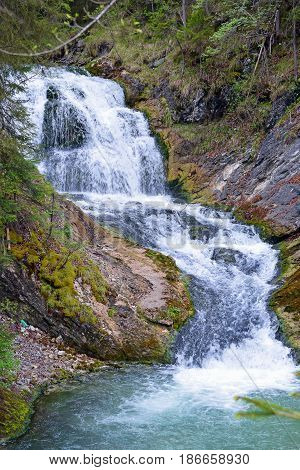 Waterfall in forest near Mittenwald, Bavaria, Germany