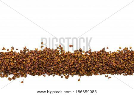 Szechuan Peppercorns in Row on Isolated White Background