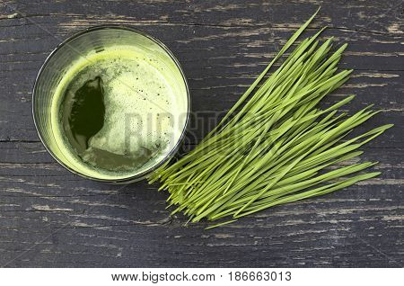Green organic wheat grass and juice ready to drink