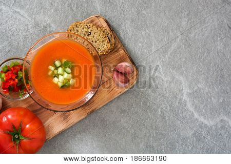 Traditional Spanish cold gazpacho soup on gray stone.