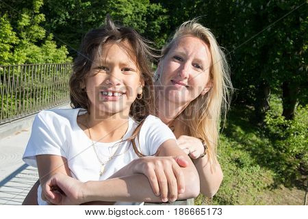 a blonde mother with her brown daughter
