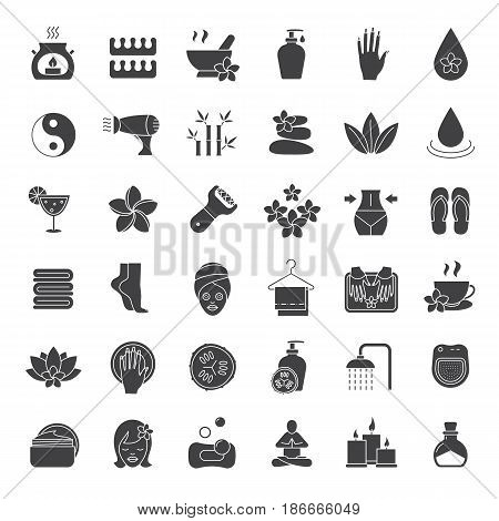 Spa salon glyph icons set. Aromatherapy silhouette symbols. Oil drop, mortar and pestle, foot file, cream, plumeria flower, hairdryer, towels, flip flops, shower, candles. Vector isolated illustration